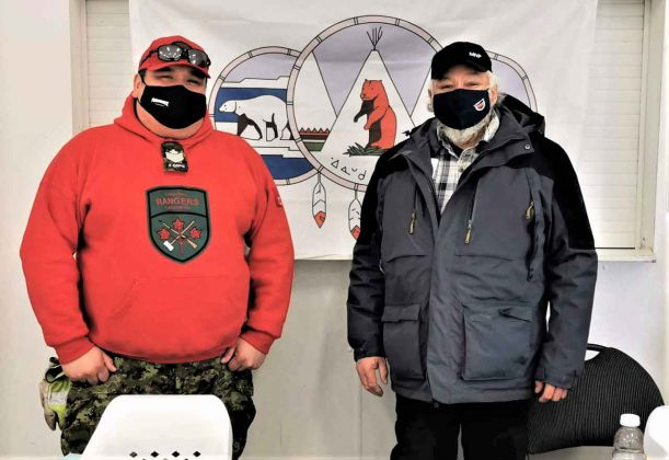 Sergeant Matthew Gull and Chief Abraham Hunter check out the progress of Covid-19 vaccinations Peawanuck. Credit Master Corporal Pamela Chookomoolin, Canadian Rangers