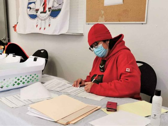 Ranger Linda Hunter keeps track of vaccination records in Peawanuck as residents get their their second Covid shots. credit Master Corporal Pamela Chookomoolin, Canadian Rangers