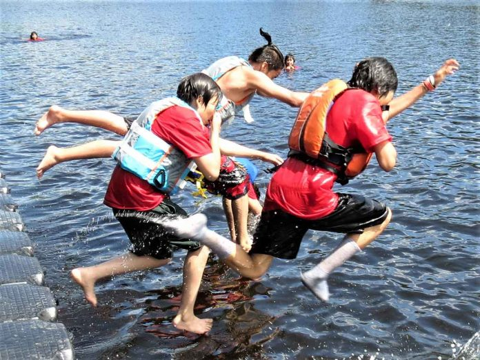 Junior Canadian Rangers jump into Springwater Lake for a cooling dip at Camp Loon 2019. credit Sergeant Peter Moon, Canadian Rangers