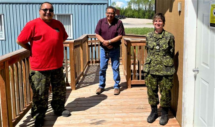Sergeant Freeman Ningewance, left, with Lac Seul Chief Clifford Bull, centre, and Sergeant Janet Butt. credit Ranger Terrance Angeconeb, Canadian Rangers