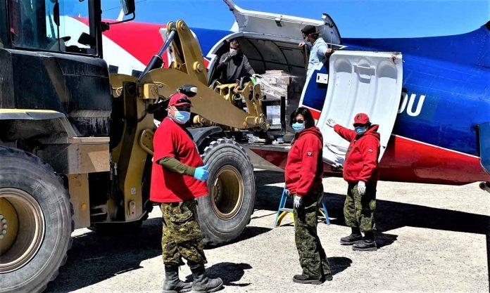 Canadian Rangers unload a cargo plane at Kashechewan airport. credit Sergeant Janet Butt, Canadian Rangers