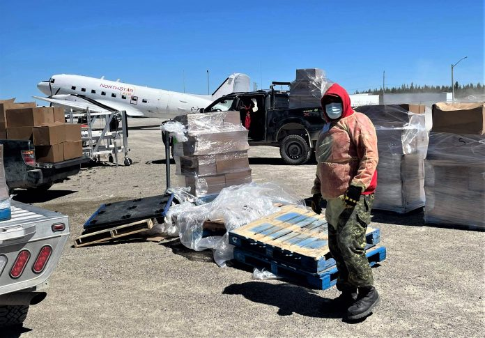 Ranger Malachi Wynne organizes food for delivery to families confined to their homes by a 24-hour curfew in Kashechewan. credit Canadian Rangers