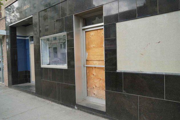 Lots of broken windows and doors speak to the problems in the area
