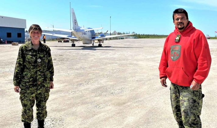 Sergeant Janet Butt, left, at Kashechewan airport with Master Corporal Joe Lazaus of the Canadian Rangers credit Canadian Rangers