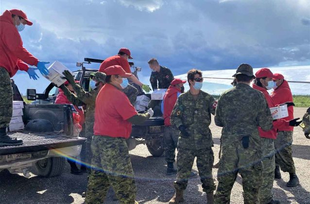 Sergeant Janet Butt supervised a joint team of Canadian Rangers and soldiers during the unloading of cargo aircraft at Kashechewan airport. credit Sergeant Janet Butt, Canadian Rangers