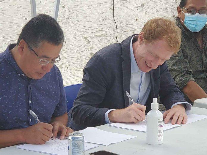 Signing at Grassy Narrows