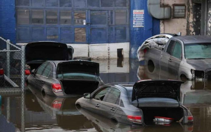 Cars sit in water after flooding in the Bronx borough of New York City, U.S., September 2, 2021. REUTERS/Caitlin Ochs