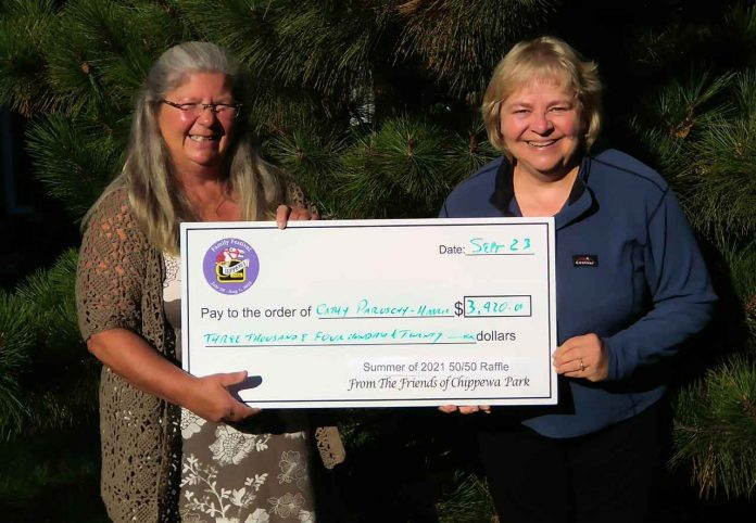Cathy Sawicki, on the left, presents the winning cheque from The Friends of Chippewa Park's Summer 2021 50/50 Draw to Cathy Paroschy-Harris. Ms Paroschy-Harris won $3,420. A total of $22,662 in prizes from two 50/50 draws along with the ongoing Catch the Chippewa Park Ace lottery have been awarded so far.